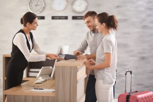 Guest satisfaction: Receptionist Assisting Customers